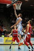 KAPOSVAR, HUNGARY - MARCH 8: Roland Hendlein (white 11) in action at a Hungarian Championship basket