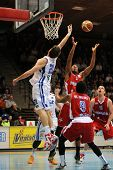 KAPOSVAR, HUNGARY - MARCH 8: Marton Horvath (white 21) in action at a Hungarian Championship basketb