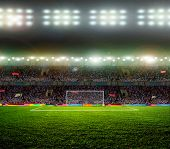 pic of grass area  - Soccer ball on the field of stadium with light - JPG
