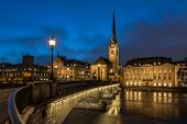 stock photo of nightfall  - Illuminated Fraumunster Church and River Limmat in Zurich Switzerland - JPG