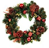 stock photo of christmas wreath  - A decorated Christmas wreath with pine cones and ornaments - JPG