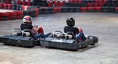 Indoor karting race (2 kart and safety barriers)