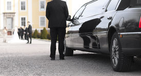 stock photo of mansion  - Black limo with driver waiting for bride and groom in front of mansion - JPG