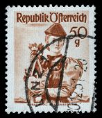 AUSTRIA - CIRCA 1949: A stamp printed in Austria shows woman in national dress, Vorarlberg, Bregenze