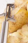Potatoes With Peeler And Peeled Skin