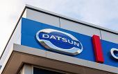 Samara, Russia - August 30, 2014: Datsun Dealership Sign Against Blue Sky. Datsun Is An Automobile B