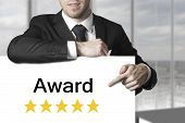 Businessman Pointing On Sign Award Golden Rating Stars