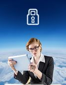 Redhead businesswoman using her tablet pc against blue sky over clouds at high altitude