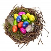 Chocolate Easter Eggs In Nest On White Background