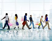 Group of Diverse People Walking in a Shopping Mall