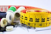 Tape measuring  and spools of threads backgroun white