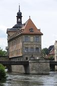 pic of regnitz  - Bamberg is a famous historical town in Germany with the landmark city hall inside the river regnitz - JPG