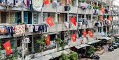 Old apartment building decorated by Vietnam national flags