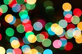 Holiday Background With Colorful Unfocused Lights