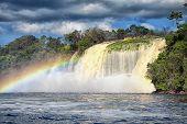 Powerful waterfall and a rainbow