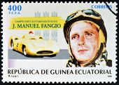 stamp printed in Guinea dedicated to car champions shows Juan Manuel Fangio