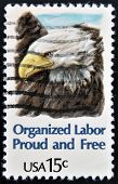 stamp printed in United States of America shows America Bald Eagle Organized Labor Proud and Free