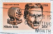 A stamp printed in USA shows Induction motor and portrait of  Nicola Tesla