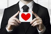 Businessman Holding Sign Red Heart Symbol