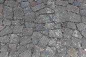 Gray Canarian natural stone wall