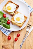 Croque madame on a wooden table