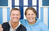 picture of gay couple  - A colour portrait photo of a handsome friendly gay male couple both smiling at the camera - JPG