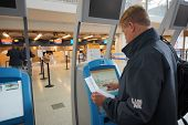 HELSINKI - SEP 03: self check-in kiosks on September 03, 2014 in Helsinki, Finland. Helsinki Airport  is the main international airport of the Helsinki metropolitan region and the whole of Finland