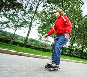 Red-haired Teenage Boy Rollerskating
