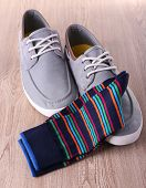 Top-Siders and socks on wooden background