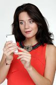beautiful young woman in the hands of mobile phone