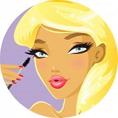 Cute blonde applying mascara
