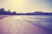 Retro Vintage Filtered Picture Of A Beach At Sunrise.