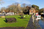 Christchurch Dorset England UK with view of riverside including swans
