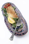 fish dinner on ceramic platter; angled fork