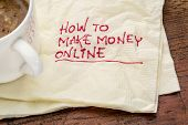 How to make money online - handwriting on a napkin with a cup of coffee