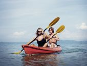 Travel Beach Adventure Kayaking Couple Holiday Concept