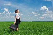 girl in suit walking on a field