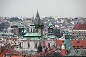 Saint Nicholas Church in Old Town Square and the Old Town Hall viewed from the Letna Park in Prague, Czech Republic.