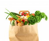 Multiple different vegetables in paper bag