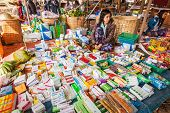 INLE LAKE, MYANMAR - JANUARY 7, 2014: Woman selling medicines and drugs at rural market