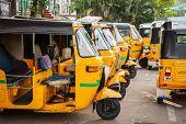 CHENNAI, INDIA - JULY 25, 2009: Indian auto rickshaws in street. Auto rickshaws (aka