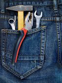 Instruments in a back pocket of a jeans