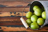 Brazilian Fruit Spondias Tuberosa (brazil Plum, Imbu, Umbu) In Small Bucket On Wooden Table