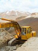 pic of excavator  - Excavator working on a precipice in the Himalayas (India) ** Note: Soft Focus at 100%, best at smaller sizes - JPG