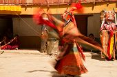 The Monk Performs A Religious Mask Dance During The Cham Dance Festival