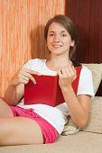 Girl  Reading On Sofa