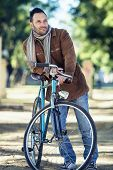 Man With Old Bike And Corduroy Jacket In The Park