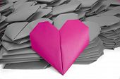 One Pink Paper Heart In A Pile Of Grey Ones For Valentine's Day