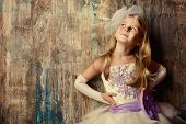 Art portrait of a pretty little girl wearing princess dress. Fashion shot. Childhood.