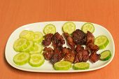 grilled meat with sliced cucumber